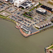 Aerial view of parking lot for vehicles on the bank of river - Stock Photo