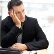 Unhappy young business man looking away - Stock Photo