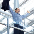 Royalty-Free Stock Photo: Achievement - Excited young businessman standing by a railing