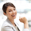 Cute young business woman smiling - Stock Photo
