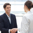Successful young business executives shaking hands with eachothe - Stock Photo