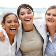 Royalty-Free Stock Photo: Friendly businesswoman standing with her colleagues