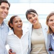 Multi ethnic group of business associates rejoicing success - Stock Photo