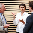Professional businesspeople discussing business issues - Stock Photo