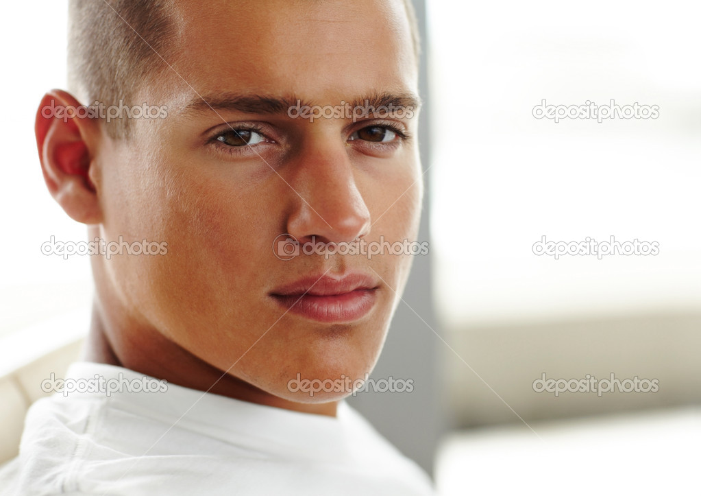 Closeup portrait of smart young guy looking confidently  Stock Photo #3461895