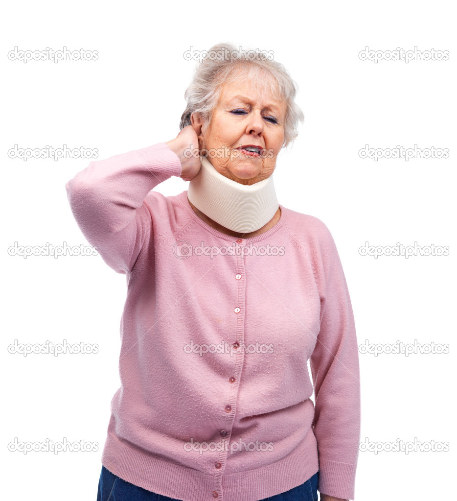 Senior female suffering from neck pain while wearing neck brace on white background — Stock Photo #3462397