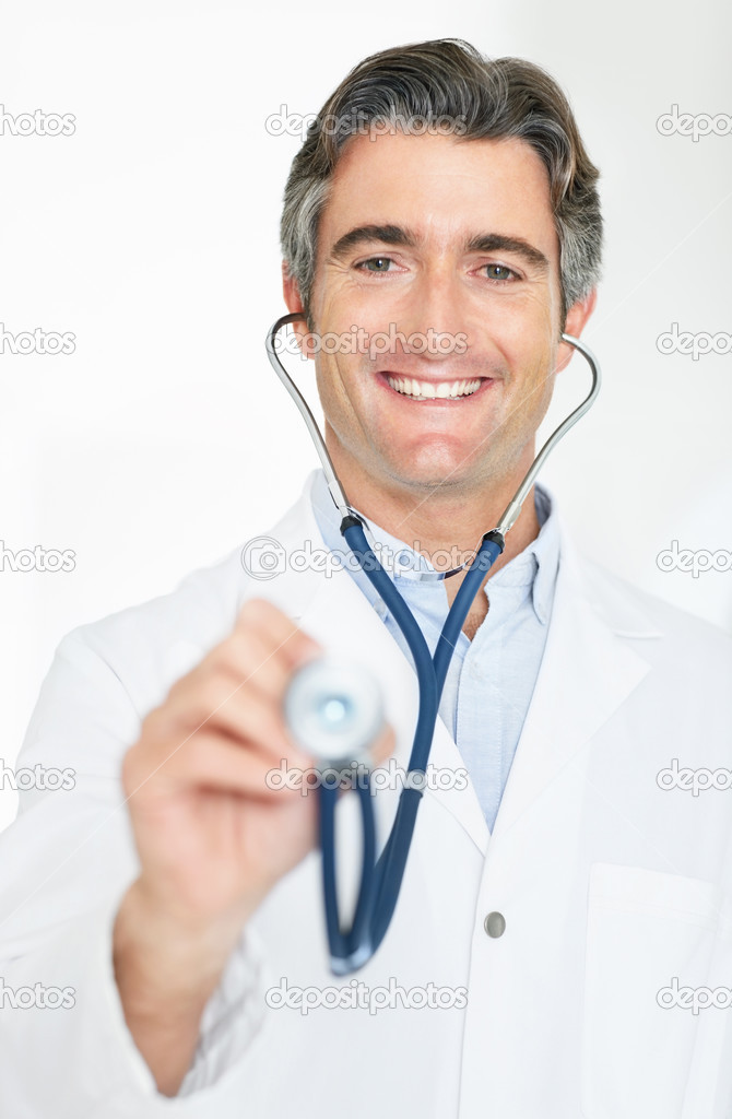Portrait of a smiling mature male doctor holding a stethoscope for medical ...