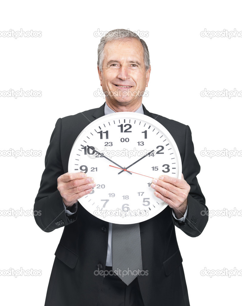 Portrait of a mature old male entrepreneur holding a wall clock in hand on ...