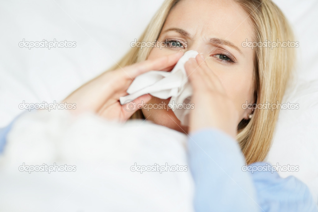 Closeup of a young woman having cold on bed — Stock Photo #3463655
