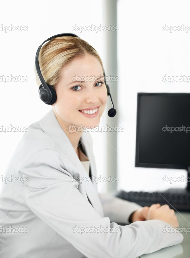 Portrait of a friendly telephone operator in an office environment  Stock Photo #3463792