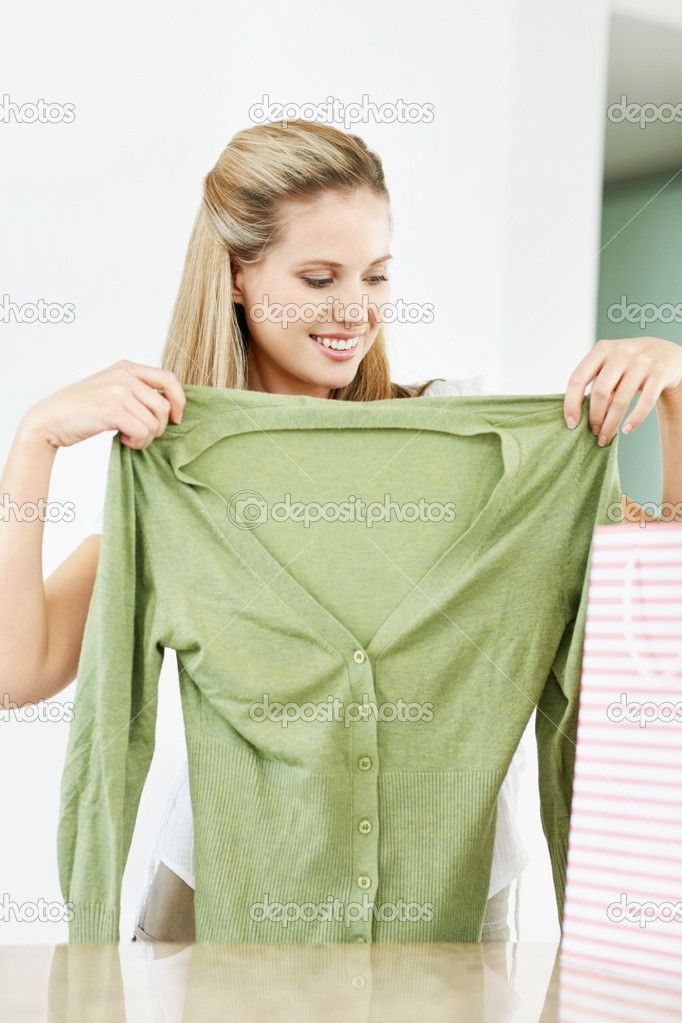 Portrait of a happy young woman trying her new green top  Stock Photo #3463965