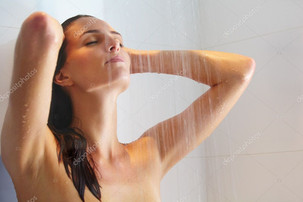 Portrait of a beautiful young female bathing under shower  Stock Photo #3464023