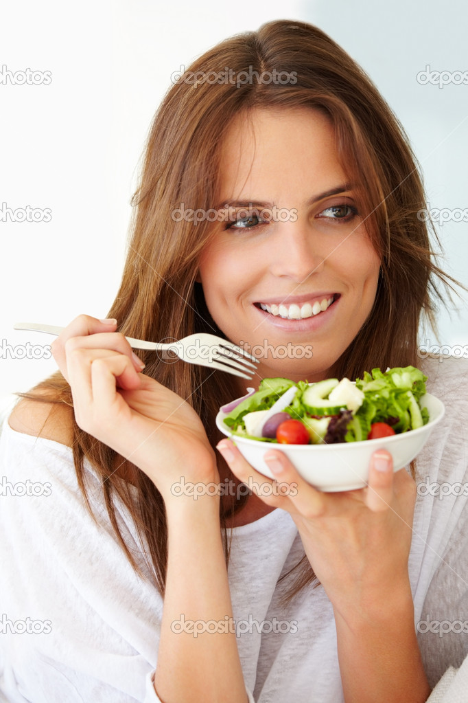 Closeup of a pretty young lady eating fruit salad  Stock Photo #3464029