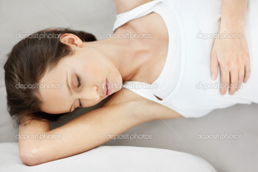 Top view of a young Caucasian female fast asleep on the couch — Stock Photo #3464427