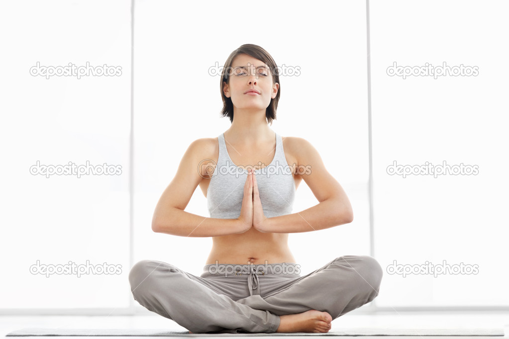 Portrait of a young fitness woman practicing yoga in the lotus pose — Stock Photo #3464942