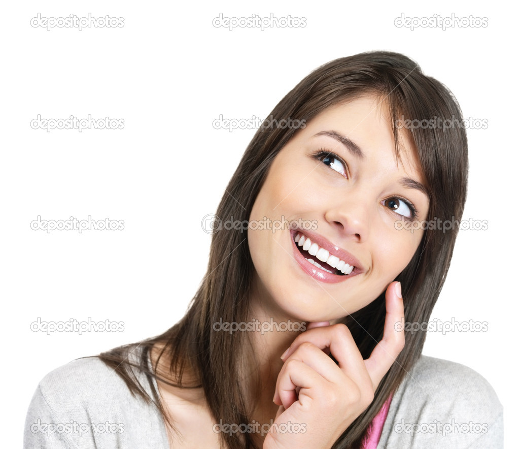 Portrait of a happy young female looking thoughtfully at copyspace  Stock Photo #3465248