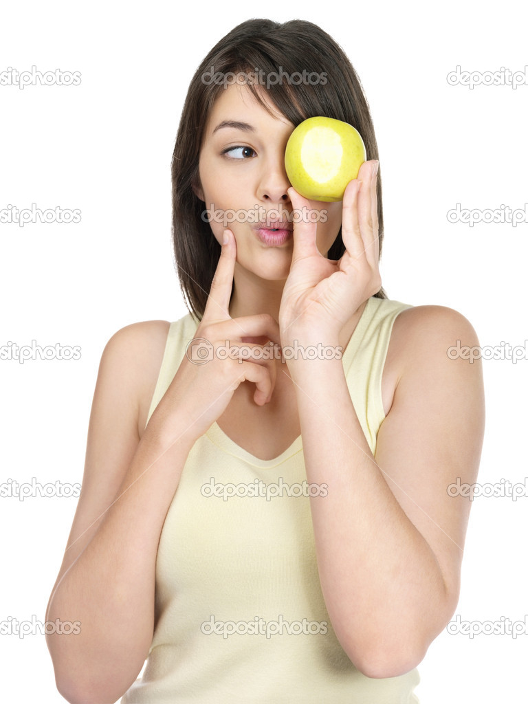Portrait of a pretty female holding a green apple against white — Stock Photo #3465482