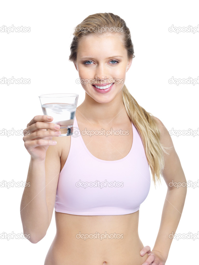 Portrait of a smiling young female holding a glass of water isolated against white — Stock Photo #3466184