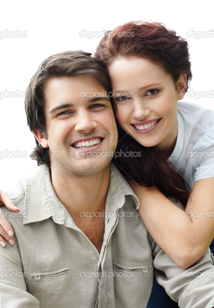 Portrait of a smiling young couple sitting together against white — Stock Photo #3466688