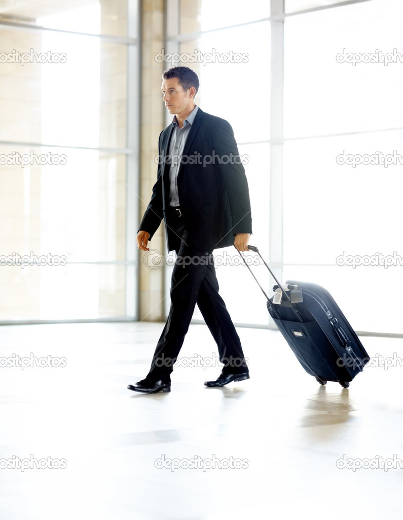 Portrait of a successful young business man walking with travel bag — Stock Photo #3467050