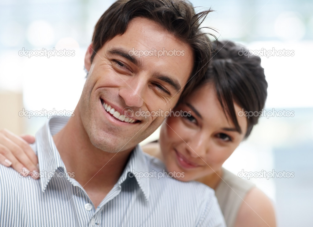 Closeup portrait of a happy young couple together over a bright background   Stock Photo #3467462