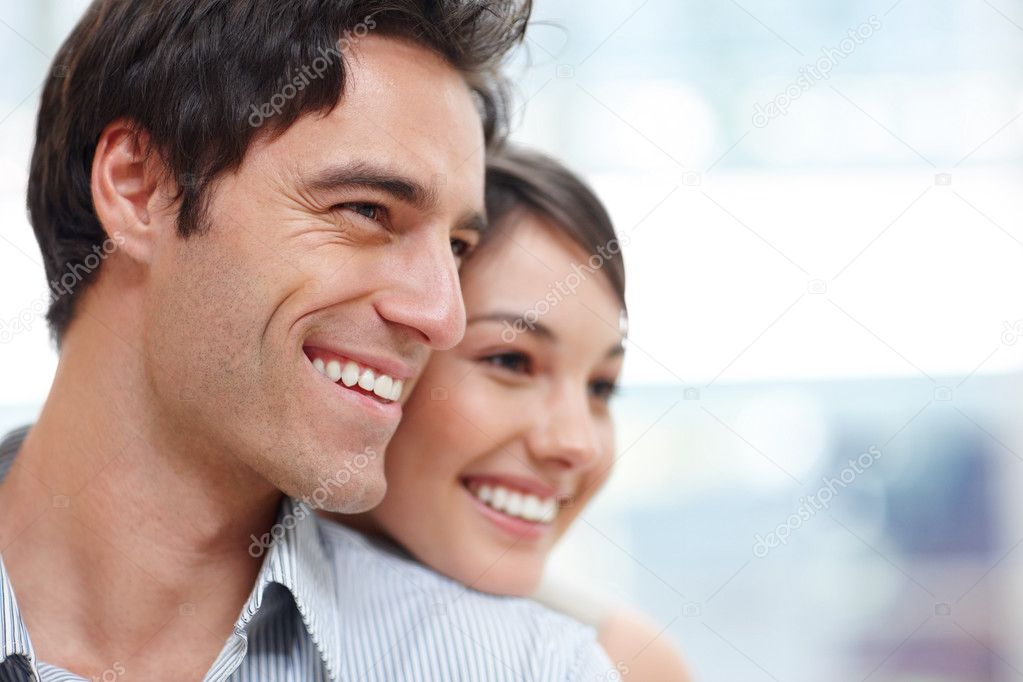 Closeup portrait of a happy young couple looking at something interesting - Copyspace — Stock Photo #3467467