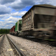 Cargo train speeding - Stock Photo