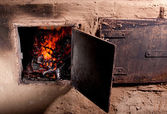 Old stove in a village house — Stock Photo