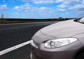 New car alongside the road — Stock Photo