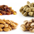 Selection of raisins, peanuts, pistachios and almonds — Stock Photo