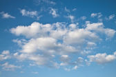 Blue sky and lots small clouds — Stock Photo