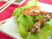 Shrimp and octopus, mounted on skewers. — Stock Photo