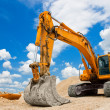 Stock Photo: Yellow Excavator at Construction Site