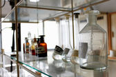 Lab interior of shelves and bottles — Stock Photo