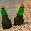 Cold beer on beach sand — Stock Photo