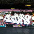 Graffiti on the Embankment: London — Stock Photo