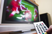 Watching soccer on TV — Stock Photo