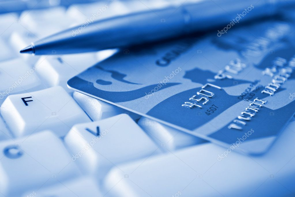 Credit card over a keyboard — Stock Photo #3585514