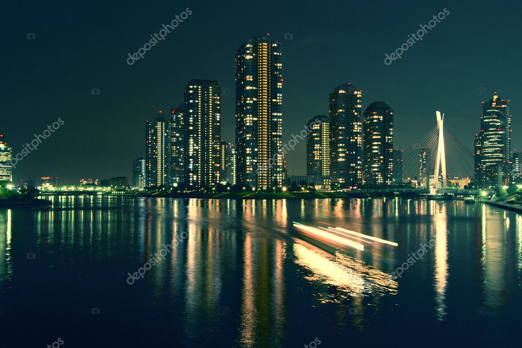 Modern Tokyo buildings with night reflection in water and light traces of moving ship, Japan — Stock Photo #3133085