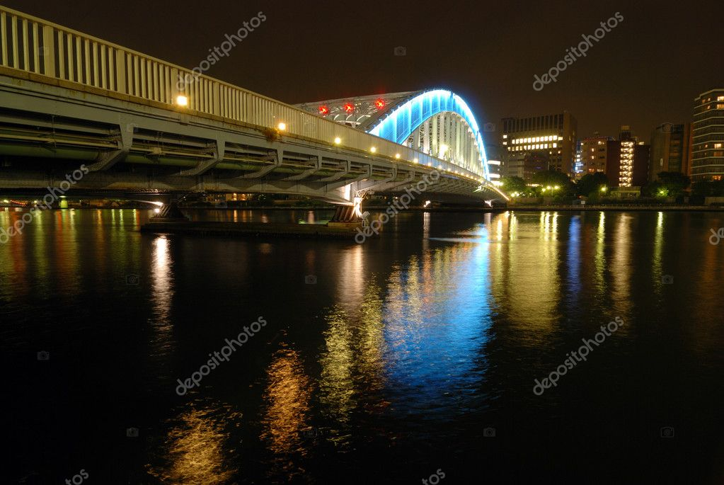 Nighttime colorful reflection of Eitai Bridge illumination in waters of Sumida river at central part of Tokyo Metropolis, Japan — Stock Photo #3133092