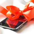Cellular telephone in a gift — Stock Photo