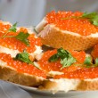 Sandwiches with red caviar. — Stock Photo #2744789