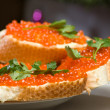 Sandwiches with red caviar. — Stock Photo