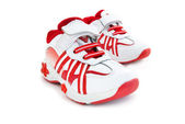 Red-white kids training shoes. — Stock Photo