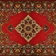 Royalty-Free Stock Photo: Red Ornate Traditional Carpet Texture