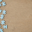 Left side abstract simple puzzle game pieces. - Stock Photo