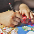 Stock Photo: Hands and topographic map