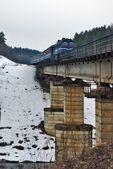 Passenger train in winter landscape — Stock Photo