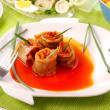 Herring rolls in salsa sauce  for easter - Stock Photo