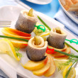 Herring rolls  with apple - Stock Photo